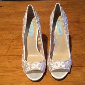 Betsy Johnson white lace peep toe heels.